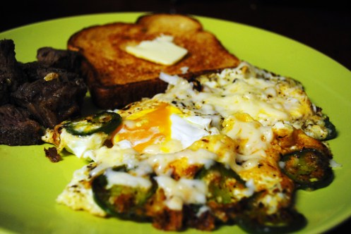 steak and eggs, japapenos, cheese, toast