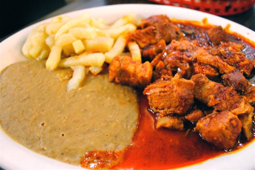 chicharron guisado traditional pork with tomato sauce