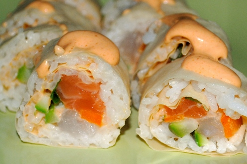 Spicy Sea Monster salmon fluke jalapeno avocado wrapped in soy paper and topped with spicy mayo