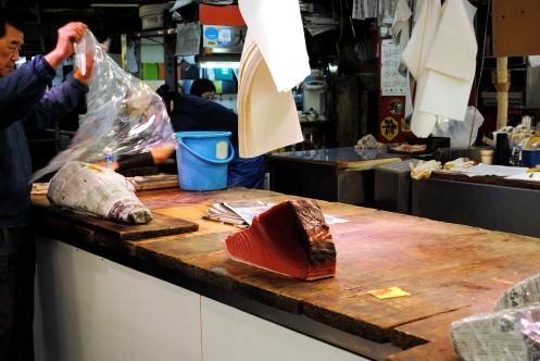 a big slab of tuna being packaged tokyo