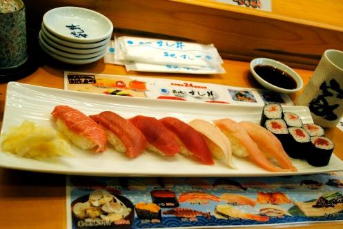 different types of tuna nigiri and a tuna roll tokyo