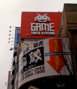 large sign from taito station showing a space invaders character from Tokyo